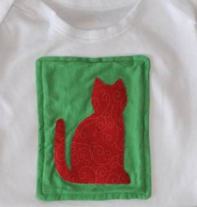 Sitting cat applique on baby onesie or baby vest