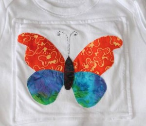 Appliqued butterfly on baby vest or baby onesie with a bit of handsewing