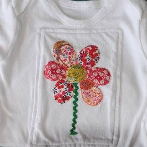 Flower applique onto baby onesie or vest