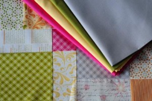 Picture of a Disappearing 9 patch block with 4 solid fabrics alongside