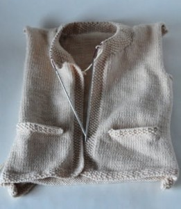 hand knitted baby cardigan incomplete