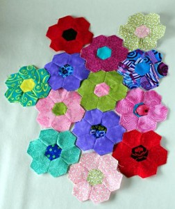 Hexagon flowers from scrap fabrics