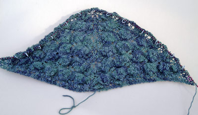 Shetland Triangle Shawl in progress in a peacock blue/green 4ply yarn