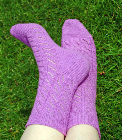 Diagonal Lace socks in purple Koigu KPM