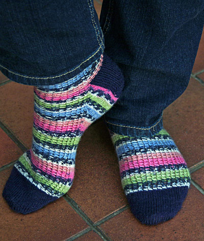 Toe up socks with navy toes, heels & cuffs & stripy foot/legs