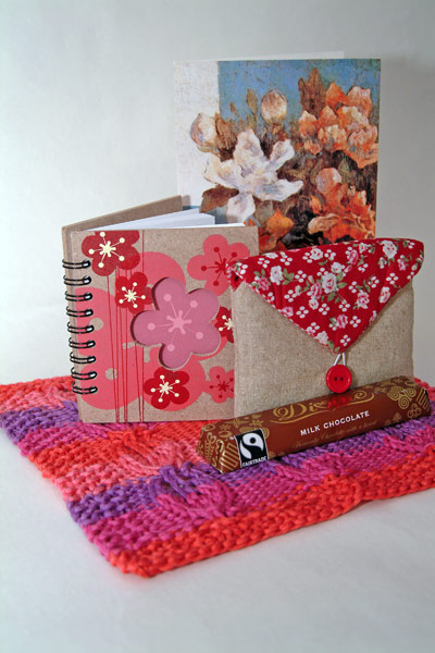 Dishcloth & gifts including a small notebook, purse & a bar chocolate