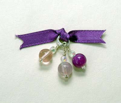 Stitch markers with a purple bow tying them together